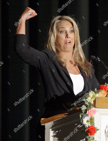 Fitness expert Denise Austin speaks at a memorial service for fitness guru Jack LaLanne, in Los Angeles . LaLanne died Jan. 23 at the age of 96
