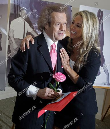 Stock Image of Fitness experts Richard Simmons, left, and Denise Austin attend a memorial service for fitness guru Jack LaLanne, in Los Angeles, . LaLanne died Jan. 23 at the age of 96