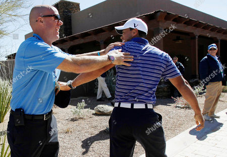 Stock Image of Tiger Woods, David Pillsbury Tiger Woods, right, greets PGA Tour staff member David Pillsbury before a practice round on the second day of practice for the Accenture Match Play Championship golf tournament, in Marana, Ariz