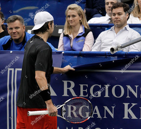 Robert Kendrick, Milos Raonic Robert Kendrick rips a banner after losing a point to Milos Raonic, of Canada, in a quarterfinal round match at the Regions Morgan Keegan Championships tennis tournament, in Memphis, Tenn. Kendrick received a warning for unsportsmanlike conduct. Raonic won 6-4, 3-6, 6-3