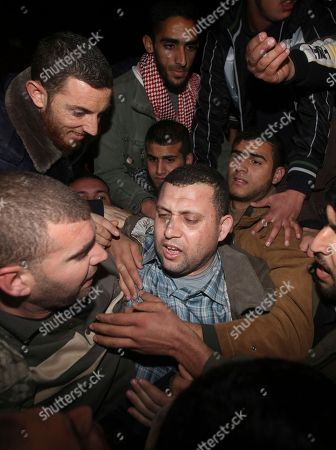 Stock Picture of Ayman Nofal A top Hamas armed commander Ayman Nofal is greeted by Hamas supporters upon his arrival at his home in Nusairat refugee camp in the Central Gaza strip, . The Palestinian militant group Hamas says one of its members has escaped from a prison in Egypt where he was accused of plotting bomb attacks. Ayman Nofal escaped last week during the anti-government unrest gripping Egypt and made his way into the sealed Gaza Strip through a smuggling tunnel under the border on Saturday. He was greeted by a celebratory crowd, some of whom fired shots in the air.Hamas says Nofal was arrested in 2008 in Egypt but denies he was plotting bomb attacks there. A Hamas official did not say how Nofal escaped. He spoke on condition of anonymity due to the sensitivity of the issue.Egypt's government is wary of the Islamic militants of Hamas, having battled for years against local militants
