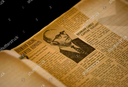 """Stock Photo of Rafael """"Rafi"""" Eitan, Gabriel Bach, Avraham Shalom Ben-Dor, Joe klein, Shaul Shaul A newspaper clip showing Nazi SS officer Adolf Eichmann during his trial is seen during a discussion in Jerusalem on the U.N.'s annual Holocaust Remembrance Day, . Fifty years after Nazi criminal Adolf Eichmann was brought to justice, the men who captured and prosecuted the Holocaust mastermind held a rare reunion Thursday in the Jerusalem hall where his famous trial took place"""