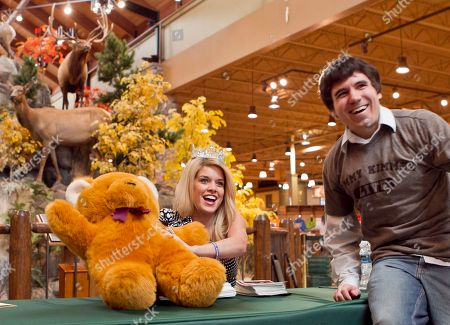 Teresa Scanlan, Chris Bernheisel Teresa Scanlan, Miss America 2011, poses for a photo with Omaha fan Chris Bernheisel, who gave her a large teddy bear as a gift during an autograph stop at Cabela's store in La Vista, Neb., . Miss America is on the last day of her homecoming tour of Nebraska