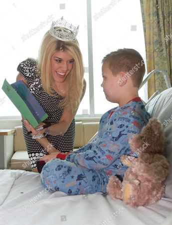 Teresa Scanlan, Caleb Schwerdtfeger Teresa Scanlan, Miss America 2011, smiles as she receives a greeting card from Caleb Schwerdtfeger of Lincoln, Neb. while visiting the Children's Hospital and Medical Center in Omaha, Neb., . Teresa Scanlan is on the last day of her homecoming tour of Nebraska