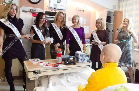 Teresa Scanlan, Jacquie Brown, Caroline Bright, Brittany Decker, Levi Dybdal Teresa Scanlan, Miss America 2011, right, is joined, from left, by Miss Oklahoma Emoly West, Miss Hawaii Jalee Fuselier, Miss Washington Jacquie Brown, Miss Vermont Caroline Bright and Miss Connecticut Brittany Decker, as they sing happy birthday to 12-year-old Levi Dybdal of Seward, Neb., while on a visit to Children's Hospital and Medical Center in Omaha, Neb., . Scanlan is on the last day of her homecoming tour of Nebraska