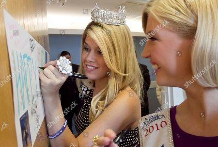 Teresa Scanlan, Caroline Bright Teresa Scanlan, Miss America 2011, with Miss Vermont Caroline Bright, right, signs the birthday poster of 12 year-old Levi Dybdal of Seward, Neb., unseen, while on a visit to the Children's Hospital and Medical Center in Omaha, Neb., . Teresa Scanlan is on the last day of her homecoming tour of Nebraska
