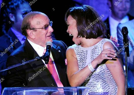 Whitney Houston, Clive Davis Producer Clive Davis shares a moment with singer Whitney Houston performs at the pre-Grammy gala & salute to industry icons with Clive Davis honoring David Geffen in Beverly Hills, Calif. The demand is overwhelming for Clive Davis' annual pre-Grammy gala. The gala has featured performances from top acts like Whitney Houston, Aretha Franklin and Carlos Santana. This year, The Kinks will take the stage to play a medley of their hits, with the help of Jackson Browne and Elvis Costello. Mumford & Sons are hoping to arrive in time to get in on the performance, Davis said