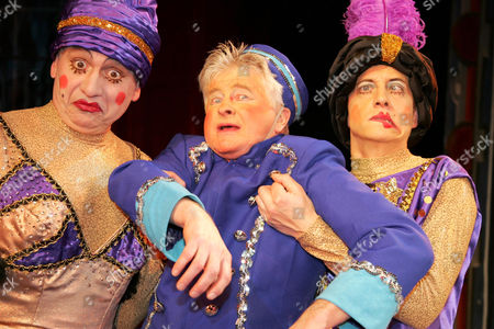 Chris Harris as Buttons with Jon Monie and Mark Buffery as The Ugly Sisters