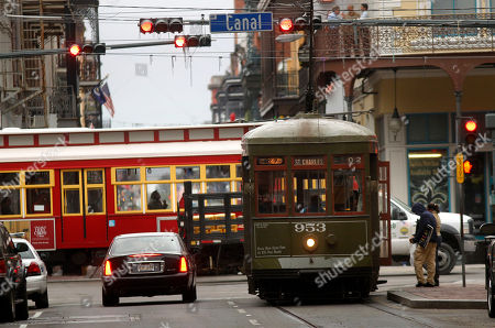 """Streetcars are seen in downtown New Orleans, . In another sign that New Orleans is reinventing itself by restoring its past, the city announced plans Tuesday to spend up to $90 million to lay streetcar tracks downriver from the French Quarter, a working-class and Creole side of the Big Easy immortalized by Tennessee Williams and Marlon Brando in """"A Streetcar Named Desire"""