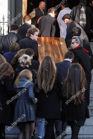 The casket of R. Sargent Shriver is carried into the church for the wake, at Holy Trinity Catholic Church in Washington Friday, Jan. 21, 2011. Shriver, an in-law of the Kennedys, and the first director of the Peace Corps, died Tuesday, he was 95