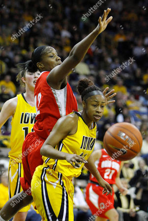 Kachine Alexander, Jantel Lavender Iowa guard Kachine Alexander, right, eyes a loose ball in front of Ohio State center Jantel Lavender during the first half of an NCAA college basketball game, in Iowa City, Iowa