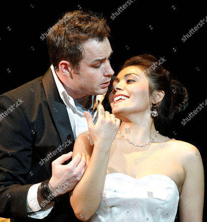 Stephen Costello and his wife Ailyn Pérez portray Romeo and Juliet during a dress rehearsal of the Opera Company of Philadelphia's production of Romeo & Juliet at the Academy of Music in Philadelphia. The production of Charles Gounod's operatic version of Shakespeare's play that opened at the Academy of Music does more than update the action from Renaissance Italy to modern times. The House of Capulet and House of Montague aren't just feuding families _ they are rival business empires that turn out competing lines of clothing