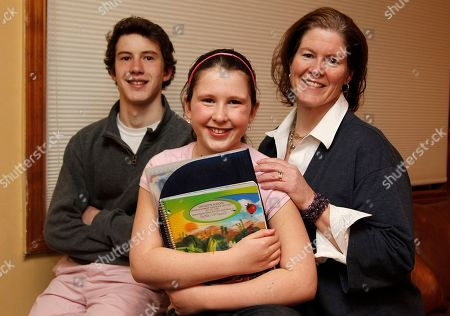 Stock Picture of Ellen Purtell, Bobby Costanzo, Grace Costanzo This photo shows Ellen Purtell, right, and her children, Bobby Costanzo, 15, left, and Grace Costanzo, 10, at their home in Chatham, N.J. Homework is getting tougher, according to Purtell who had trouble helping Bobby with homework when he was in grade school. Now she turns to her son, a sophomore at Chatham High, to help his younger sister with the work