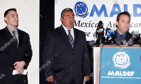 Stock Image of Jose Flores, Brian Perez, Ryan Reyes Plaintiffs, Latino police officers, from left: Jose Flores, Brian Perez, and Ryan Reyes, announce a employer discrimination suit against the Los Angeles Police Department, for unlawfully discriminating against Latino police officers and violating both federal and state employment rights, at a news conference at the Mexican American Legal Defense and Educational Fund headquarters in Los Angeles on