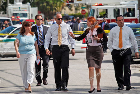 Carlos Alvarez, Nancy Perez Miami-Dade Mayor Carlos Alvarez, third from left, walks with Miami-Dade Police spokeswoman Cmdr. Nancy Perez, second from right, as they prepare to speak to the media near where a shootout erupted in a Miami neighborhood, killing two Miami-Dade police officers and a suspect, . Alvarez said the first officer had been shot once and died at the scene. The second officer, who was shot several times, was taken to a hospital and later died