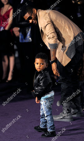"""Stock Photo of Usher, Naviyd Ely Raymond Usher and his son Naviyd Ely Raymond arrive at the premiere of the film """"Justin Bieber: Never Say Never,"""" in Los Angeles"""