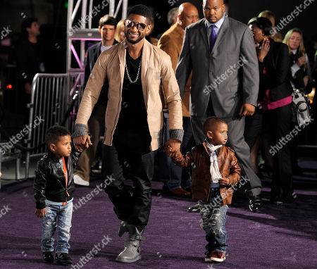 """Stock Image of Usher, Naviyd Ely Raymond, Usher Raymond V Usher, center, arrives with his sons Naviyd Ely Raymond, left, and Usher Raymond V at the premiere of the documentary film """"Justin Bieber: Never Say Never,"""" in Los Angeles"""