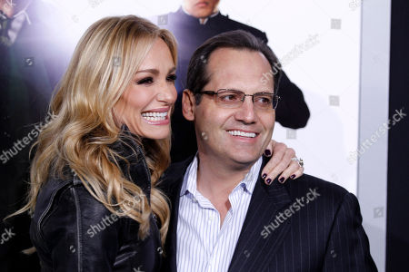 """Stock Picture of Taylor Armstrong, Russell Armstrong Reality television personalities Taylor, left, and Russell Armstrong kiss as they arrive at the premiere """"The Green Hornet"""" in Los Angeles, on"""