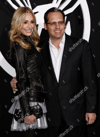"""Taylor Armstrong, Russell Armstrong Reality television personalities Taylor, left, and Russell Armstrong kiss as they arrive at the premiere """"The Green Hornet"""" in Los Angeles, on"""