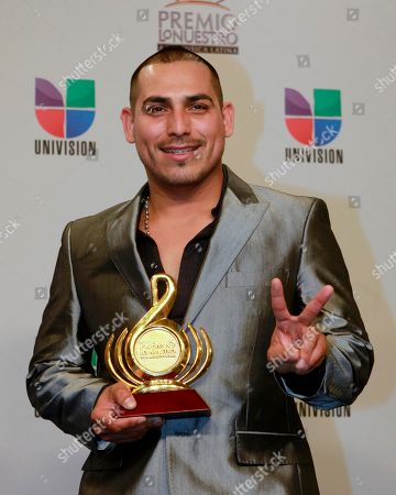 Espinoza Paz Espinoza Paz holds up his award, at the Premio lo Nuestro, Latin music award show in Miami