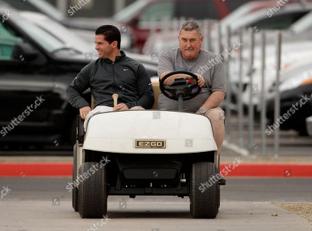 Michael Young Texas Rangers' Michael Young, left, is driven to the clubhouse by equipment manager Richard Price after reporting to baseball spring training, in Surprise, Ariz