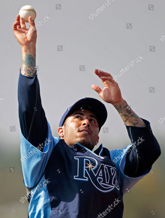 Felipe Lopez Tampa Bay Rays player Felipe Lopez shoots a baseball like a basketball during their spring training baseball workout at the Charlotte Sports Park in Port Charlotte, Fla