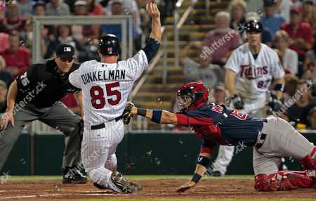 Mark Wagner, Brian Dinkelman Boston Red Sox catcher Mark Wagner puts a tag on Minnesota Twins baserunner Brian Dinkelman as he tried to score during their Grapefruit League spring training season opening baseball game at Hammond Stadium in Fort Myers, Fla