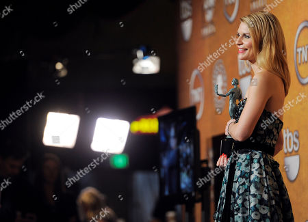 "Claire Danes Claire Danes poses with the trophy for best female actor in a television movie for her work on ""Temple Grandin"" at the 17th Annual Screen Actors Guild Awards on in Los Angeles"
