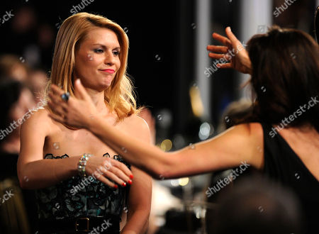 "Claire Danes Claire Danes, left, is congratulated before accepting the award for best female actor in a TV movie or miniseries for ""Temple Grandin"" at the 17th Annual Screen Actors Guild Awards on in Los Angeles"