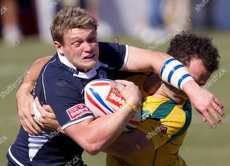 Ross Samson, Jonathon Lance Scotland's Ross Samson, center, gets tangled up with Australia's Jonathon Lance, right, during the first round of Stage 4 of the Sevens World Series Rugby tournament, in Las Vegas
