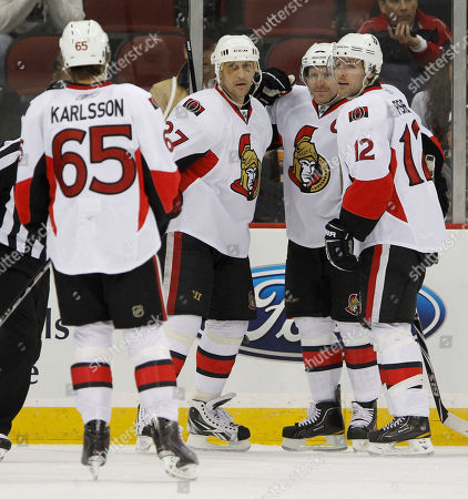 Alexei Kovalev, Erik Karlsson, Daniel Alfredsson, Mike Fisher Ottawa Senators' Alexei Kovalev (27), of Russia, gets congratulated by teammates, from left, Erik Karlsson, of Sweden, Daniel Alfredsson, of Sweden, and Mike Fisher after scoring a goal during the second period of an NHL hockey game against the New Jersey Devils, in Newark, N.J