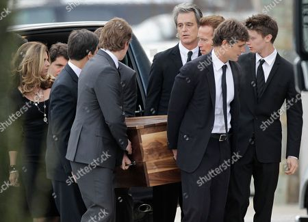 Anthony Shriver, Maria Shriver, Arnold Schwarzenegger, Bobby Shriver The casket of R. Sargent Shriver is carried into Our Lady of Mercy Catholic church for a funeral Mass in Potomac, Md., just outside Washington, . Shriver, the man responsible for launching the Peace Corps after marrying into the Kennedy family, died last Tuesday at the age of 95 after suffering from Alzheimer's disease for years. His son, Anthony Shriver, is second from right. His daughter, Maria Shriver, is at left, joined by her husband, actor and former California Governor Arnold Schwarzenegger, third from right. Shriver's son Bobby Shriver is fourth from right