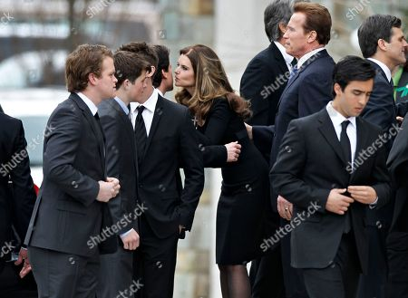 Maria Shriver, Arnold Schwarzenegger Maria Shriver, center, greets family members and other mourners as they leave the funeral Mass for her father, R. Sargent Shriver, at Our Lady of Mercy Catholic church in Potomac, Md., just outside Washington, . Shriver, the man responsible for launching the Peace Corps after marrying into the Kennedy family, died last Tuesday at age 95 after suffering from Alzheimer's disease for years. She is joined by her husband, actor and former California Governor Arnold Schwarzenegger, third from right