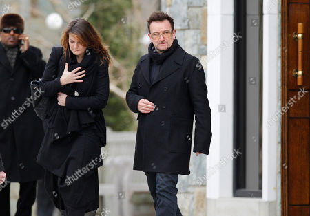 Bono, Ali Hewson Rock singer Bono, center, and his wife Ali Hewson, left, leave after the funeral Mass for R. Sargent Shriver at Our Lady of Mercy Catholic church in Potomac, Md., just outside Washington, . Shriver, the man responsible for launching the Peace Corps after marrying into the Kennedy family, died last Tuesday at age 95 after suffering from Alzheimer's disease for years