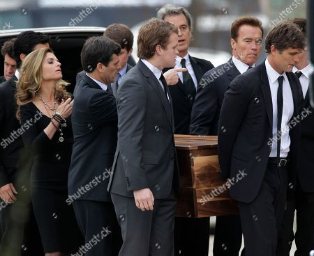 Anthony Shriver, Maria Shriver, Arnold Schwarzenegger The casket of R. Sargent Shriver is carried into Our Lady of Mercy Catholic Church for a funeral Mass in Potomac, Md., just outside Washington, . Shriver, the man responsible for launching the Peace Corps after marrying into the Kennedy family, died last Tuesday at the age of 95 after suffering from Alzheimer's disease for years. His son, Anthony Shriver, is at far right. His daughter, Maria Shriver, is at left, joined by her husband, actor and former California Governor Arnold Schwarzenegger, second from right