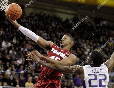 Jeremy Green, Justin Holiday Stanford's Jeremy Green, left, flies past Washington's Justin Holiday to score in the first half of an NCAA college basketball game, in Seattle