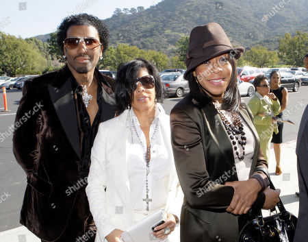 Tichina Arnold, right, Dawn Haynes and Norwood Young, left, arrive at a memorial service for singer Teena Marie at Forest Lawn-Hollywood Hills in Los Angeles . Teena Marie, whose given name was Mary Christine Brockert, died Dec. 26, 2010, at age 54