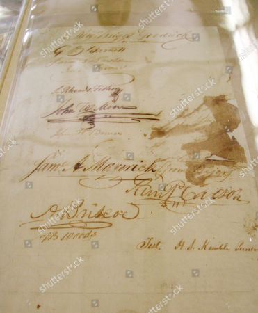 The last page of the Texas Declaration of Independence, written in 1836 is displayed in Austin, Texas. Archivists believe the big ink blotch next to the same of Samuel Maverick was caused when someone, perhaps Maverick, knocked over the ink well that was being used by the 59 signers. The 1836 document, which has become faded and brittle over the years, goes on temporary display this week at the library in Austin