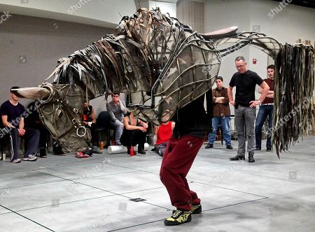 """Producer Adrian Kohler, second from right, directs an actor learning movement for one of the life-size puppets in the National Theatre of Great Britain's """"War Horse"""" at the Lincoln Center in New York"""