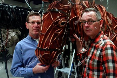 """Stock Image of Basil Jones, left, and Adrian Kohler, producers with the National Theatre of Great Britain's """"War Horse,"""" pose with one of the production's life-size puppets at Lincoln Center in New York"""