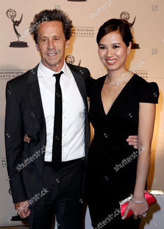 Stock Photo of Brian Grazer, Chau-Giang Thi Nguyen Brian Grazer, left, and Chau-Giang Thi Nguyen arrive at the Academy of Television Arts and Sciences 20th Annual Hall of Fame Induction Gala in Beverly Hills, Calif. on