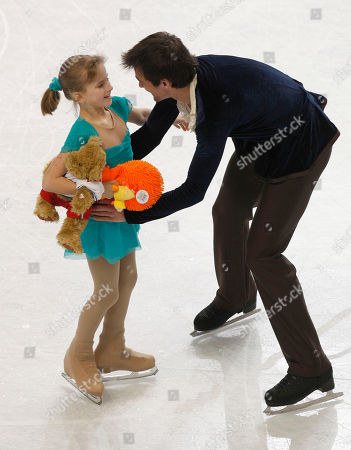 "Ryan Bradley Ryan Bradley, right, greets a ""sweeper"" with stuffed animals after his routine during the men's free skate program in the U.S. Figure Skating Championships in Greensboro, N.C"