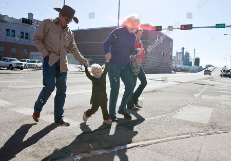 Larry Hale, Cindy Hale, Emma Claire Fritz Larry Hale, left, and his wife Cindy, visiting from DeQueen, Arkansas, and their grand daughter Emma Claire Fritz, 2, a resident of Fremont, enjoy a stroll in Fremont, Neb., . Unusually warm temperatures forecast to reach 69 degrees are experienced in the area