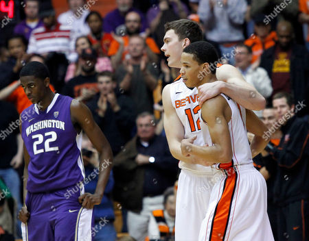 Jared Cunningham, Angus Brandt, Justin Holiday Oregon State guard Jared Cunningham, right, is hugged by teammate Angus Brandt, from Australia, as Washington forward Justin Holiday stands at left after their NCAA college basketball game in Corvallis, Ore., . Cunningham led Oregon State with 19 points as they defeated the No. 20-ranked Huskies 68-56
