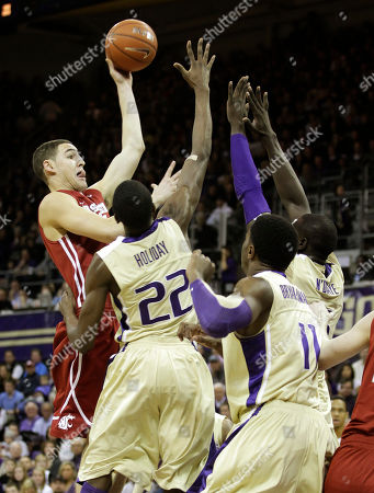Klay Thompson Washington State's Klay Thompson, left, puts up a shot as Washington's Justin Holiday (22), Matthew Bryan-Amaning (11) and Aziz N'Diaye, right, defend in the first half of an NCAA college basketball game, in Seattle
