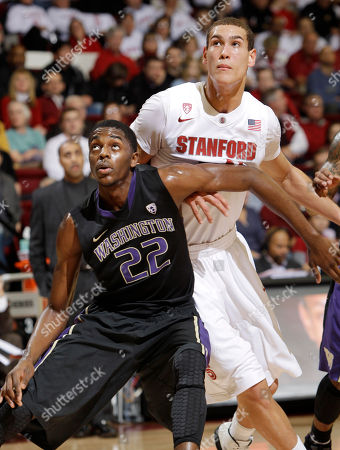 Dwight Powell, Justin Holiday Stanford forward Dwight Powell (33) and Washington forward Justin Holiday (22) battle for rebound in the first half of an NCAA college basketball game in Stanford, Calif