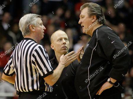 Mick Cronin, Bob Huggins, John Cahill West Virginia head coach Bob Huggins, right, and Cincinnati head coach Mick Cronin, center, talk with official John Cahill, left, after Cincinnati was called for their second technical foul in the first half of an NCAA college basketball game, in Cincinnati. West Virginia won 66-55