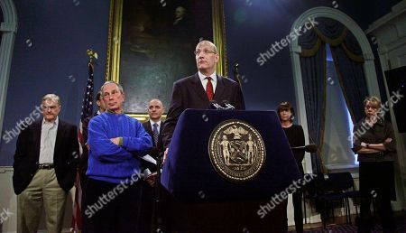 Mayor Michael Bloomberg, second from left, and key city officials including Sanitation Commissioner John Doherty, far left, and New York Schools Chancellor Cathie Black, far right, listen as MTA Chairman Jay Walden, center, speaks during a news conference, at city hall in New York. Officials gave updates on the city's snow response following a winter storm that dumped up to 19 inches snow on the region