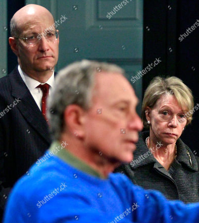 MTA Chairman Jay Walden, left, and New York Schools Chancellor Cathie Black, right, listen as Mayor Michael Bloomberg speaks during a news conference, at city hall in New York. Officials gave updates on the city's snow response following a winter storm that dumped up to 19 inches of snow on the region