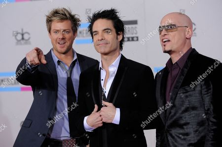 Scott Underwood, Patrick Monahan, Jimmy Stafford Scott Underwood, Patrick Monahan and Jimmy Stafford of the band Train arrive at the 38th Annual American Music Awards on in Los Angeles